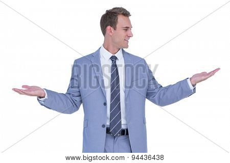 A businessman with arms up on white background