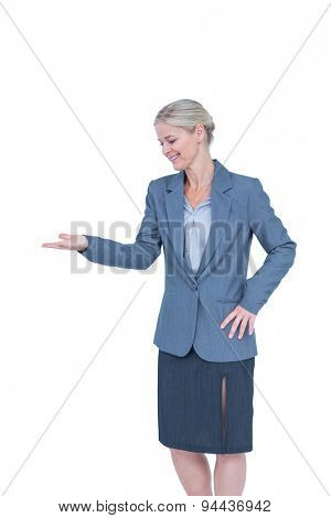 Smiling businesswoman presenting with hand on white background