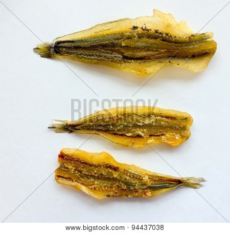 The Dried Fish on a color background.