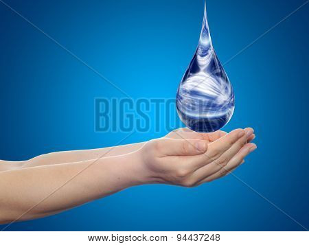 Concept or conceptual blue water or liquid drop falling in two woman hands on blue gradient background
