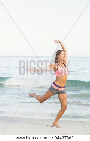 Beautiful woman jumping beside the sea at the beach