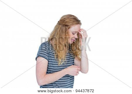 Woman with headache pinching her nose on white background