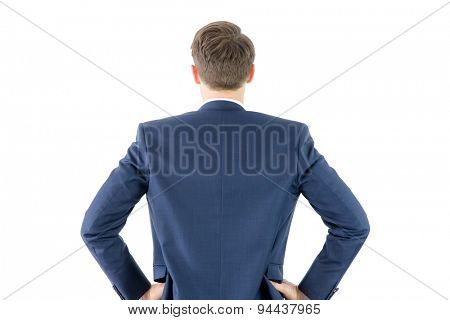 Wear view of businessman with hands on hip on white background