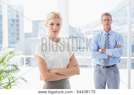 Business partners looking at camera in an office