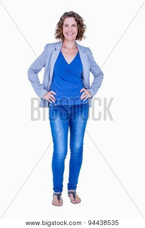 Businesswoman looking at camera with hands on hip on white background