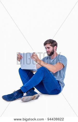 Handsome man using laptop computer on white background
