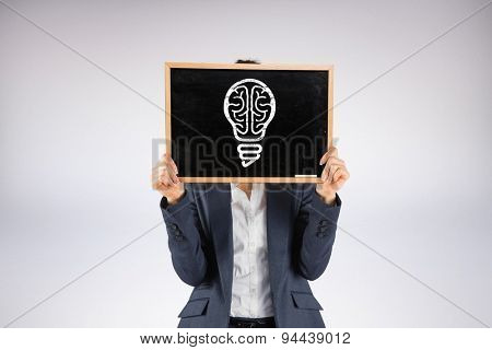 Businesswoman showing board against grey background