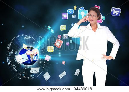 Thinking businesswoman against global communication background