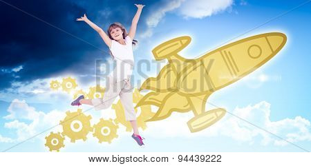 Happy girl jumping against blue sky