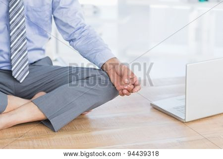 Businessman relaxing on his office in her office