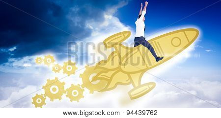 Cheering businessman against bright blue sky with clouds