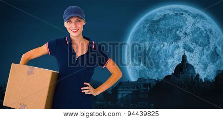 Happy delivery woman holding cardboard box against bright moon over paris