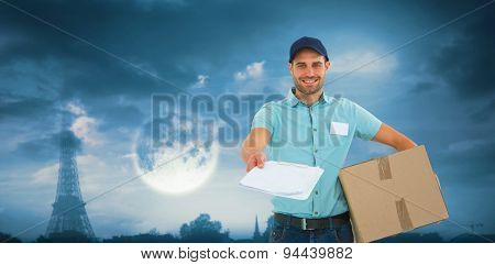 Delivery man with package giving clipboard for signature against bright moon over paris