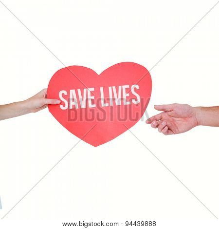 Woman giving heart card to her boyfriend against save lives