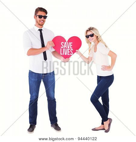 Cool young couple holding red heart against save lives