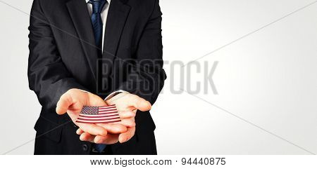 Mature businessman holding his hands out against usa national flag