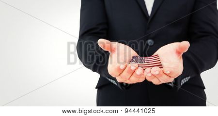 Businessman holding his hands out against usa national flag