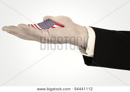 Businessman with wrist watch and hands out against usa national flag