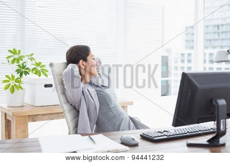 Businesswoman relaxing in a swivel chair in her office