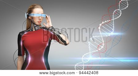 people, technology, future and progress - young woman with futuristic glasses and microchip implant or sensors over gray background with dna molecule formula