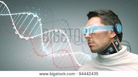 people, technology, future and progress - man with futuristic glasses and microchip implant or sensors over gray background and dna molecules