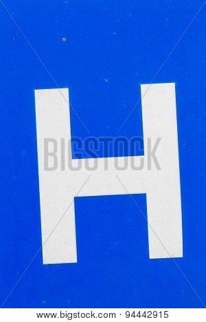 White Letter H From Traffic Road Sign