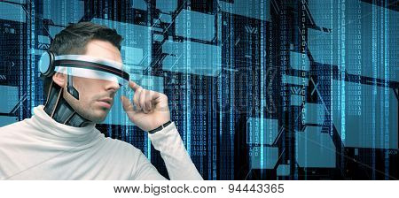 people, technology, future and programming - man with futuristic glasses and microchip implant or sensors over black background with binary system code and virtual screens