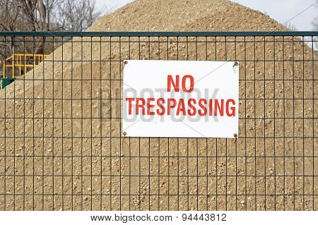 NO TRESPASSING sign at construction site