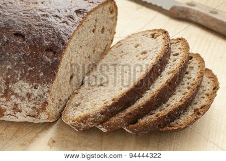 Loaf of healthy German Sourdough bread and slices