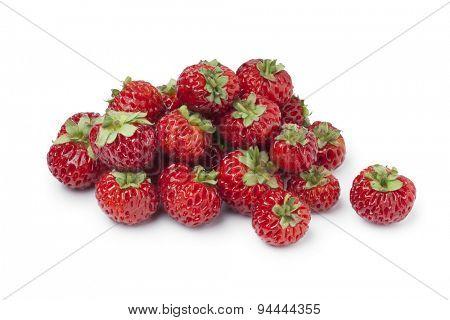 Heap of fresh ripe strawberries on white background