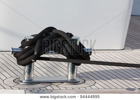 A Mooring Rope With A Knotted End Tied Around A Cleat