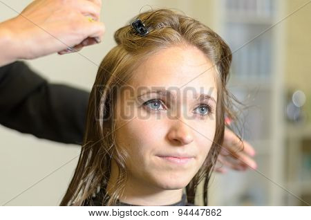 Hairstylist Cutting The Hair Of A Young Woman