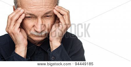 Old Man Suffering From A Headache