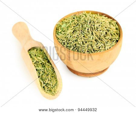 Cumin in wooden bowl, isolated on white
