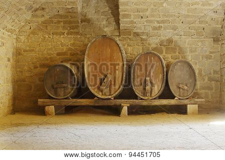 four cider or wine barrels