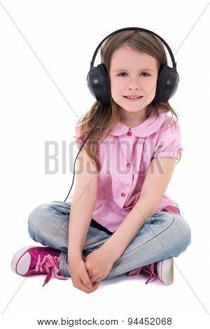 Cute Little Girl Listening Music In Headphones Isolated On White