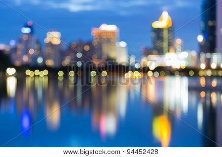 Abstract blur office building lights with water reflection