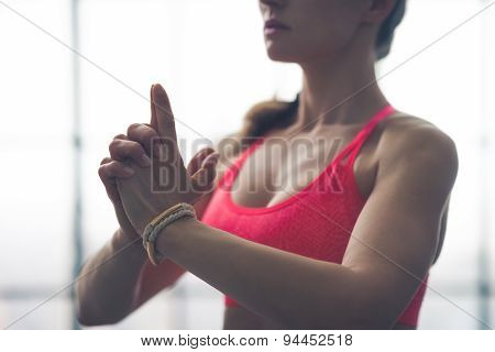 Partial View Closeup Of Fit Woman's Hands In Yoga Pose