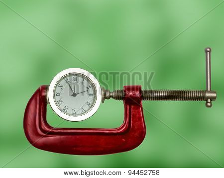 Clock Squeezed With Clamp.