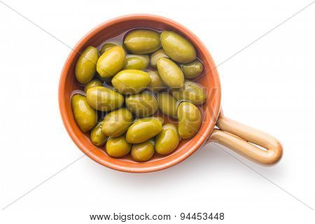 green olives in bowl on white background