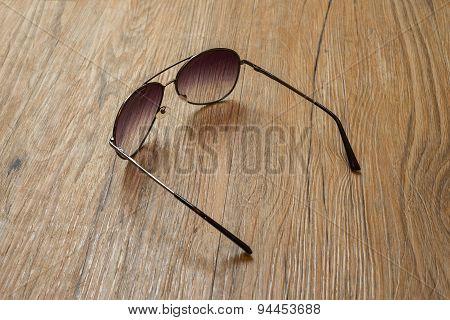 Black Sunglasses On Wooden Background