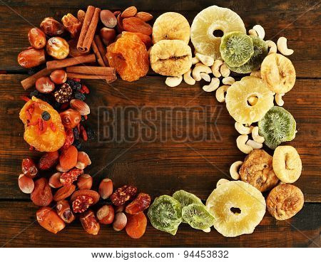 Assortment of dried fruits on wooden table, closeup