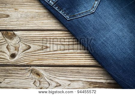 Jeans On Wooden Background Top Corner. Horizontal