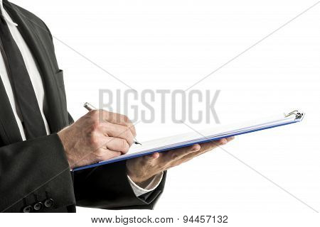 Mid Section Of Business Man Writing On Clipboard