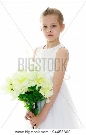 beautiful girl in a white summer dress holding