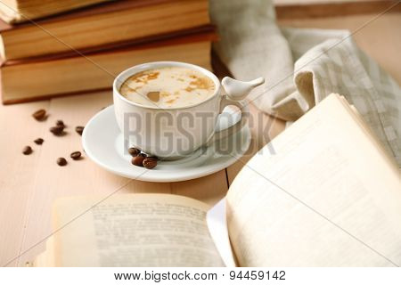 Still life with cup of coffee and books, close up