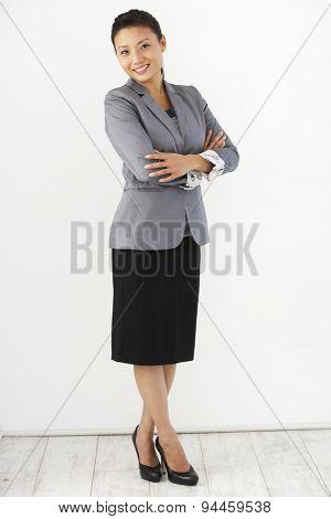 Studio Portrait Of Businesswoman Standing Against White Background