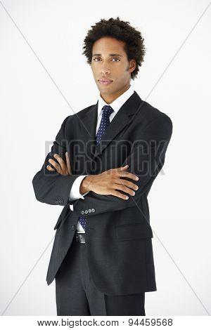 Studio Portrait Of Businessman Standing Against White Background