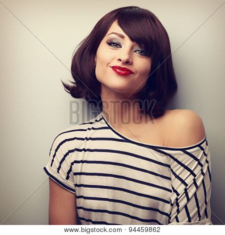 Pretty Young Woman Grimacing With Short Black Hair Style In Fashion Blouse