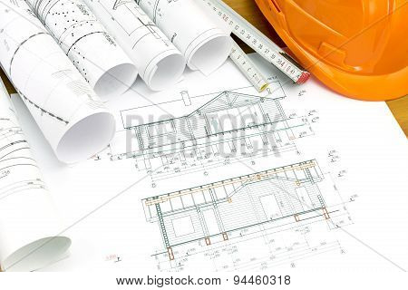 Plans Of House With Helmet And Wooden Ruler